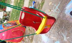 Outdoor swing with harness in good condition. Welcome