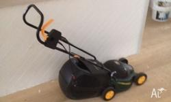 Used Ozito Electric Mower in great working condition,