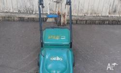 OZITO ELECTRIC MOWER PLUS CATCHER. Excellent condition.