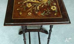This is a pair of tables which are decorated on the top