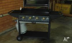 Garden grill 4 burner in as new condition. Includes gas