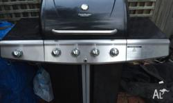 4 Burner BBQ with add-on side (wok) burner. Also comes