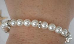 Lovely custom made Swarovski pearl and crystal bridal