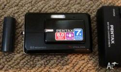 Pentax compact digital camera comes with spare battery