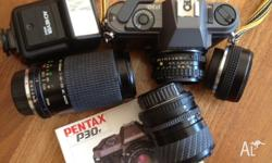 Pentax P30 in excellent condition. Comes with 3 extra