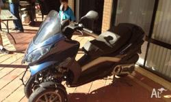 This Piaggio MP3 400 is a Statuary Write-off and can