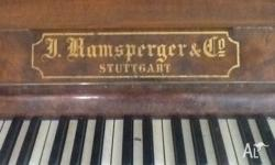 This attractive walnut piano was made by J Ramsperger &