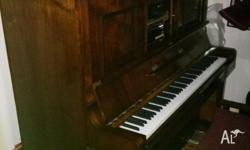 piano, also a pianola includes 16 rolls, old fashioned