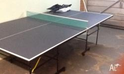 Ping pong table with net, 4 racquets and balls. Have
