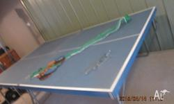 Ping Pong Table in reasonable condition. Bats and net