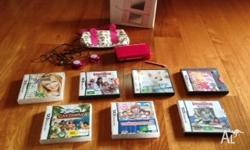 Pink DS in good condition comes with seven games and
