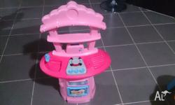 Pink pretend play plastic kitchen with cupcakes picture