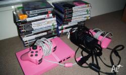 For sale is my pink ps2, complete w/ 2 controllers, 2
