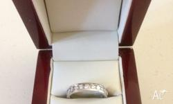 THIS ELEGANT AND STYLISH RING CONTAINS 11 CHANNEL SET