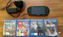 PS Vita latest model, plus 4 games and 4Gb Memory Card,