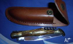 pocket knife with pouch - - - folding with a corkscrew
