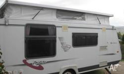 A/ Van pop top caravan,Dometic air conditioner, Roll