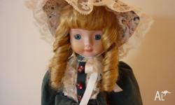 Porcelain Doll in very good condition. $6 firm. Phone