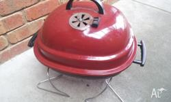 Oval shaped Charcoal BBQ with Charcoal, handy for