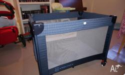 Baby Club Portable Cot in navy blue. Includes mattress