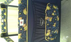 Colourful portable cot with yellow teddies designs to