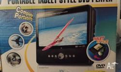 "7"" Portable tablet style DVD player. Corby TF-DVD7050."