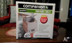 "For sale is a ""Companion"" 'Ezyloo' camping toilet. It"