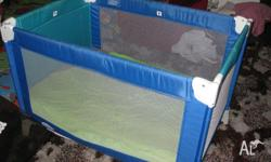 Port-a-cot is blue and torque in colour. Has no rips or