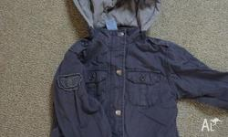 Great used condition fully lined jacket. Zip and button