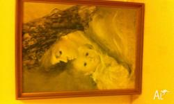 "Beautiful Print of ""Mother and Child"" in gold frame"