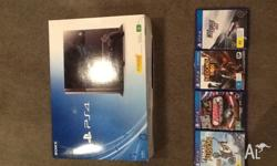 Up for sale PS4 with 4 games extra long HDMI cable with