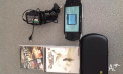 In very good condition psp with 2 games and with his
