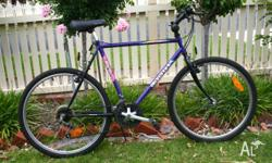 Hello, For sale purple and black bike: 18 speed,