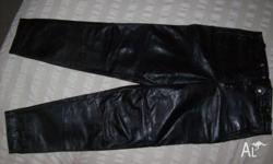 A pair of dark brown leather pants for sale. size 36.