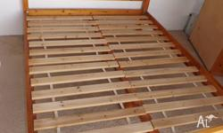 QUEEN BED FRAME PINE GOOD CONDITION. PICK UP FROM