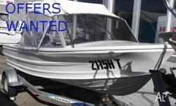 Older model Quintrex Fishabout MK2. Ready to go boating