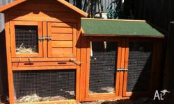 Rabbit hutch and 2 black rabbits for sale as kids have