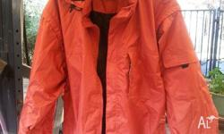 As new, XXL orange rain/wind jacket. Sleeves are also