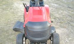 This beautiful red Ride on Mower has rarely been used.