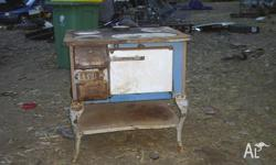 In good working order, old wood stove from about the