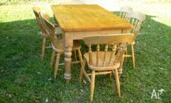 A lovely old recycled pine table and 6 colonial chairs.
