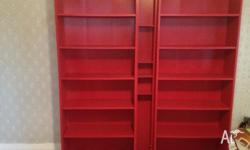 Two IKEA red bookcases and CD/DVD Shelving Unit going