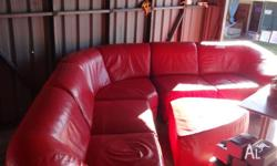 For sale Used Red Leather Corner lounge with ottoman