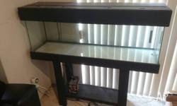 4 ' Fish tank on stand(wooden) with top, been used to