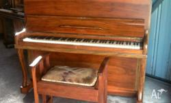 This English built iron frame 1940s piano has a lovely