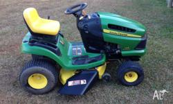 John Deere ride on mower in good condition. new mower