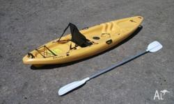 Riot Escape 9 kayak. $360, includes paddle and seat.