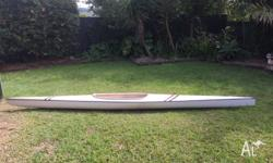 Lightweight flat water kayak with foot rudder and