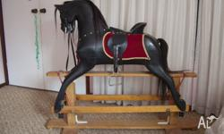 Well loved rocking horse, recently renovated. Height to