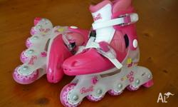 Girls Barbie roller blades. Approx size childrens 12.